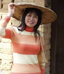 Beautiful lady wearing a 'Peasant Hat'Yu Su