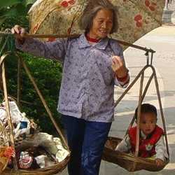 Taking chickens to the market.Her child sneaks a ride.