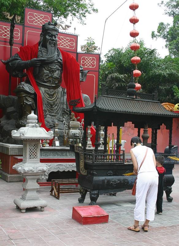 Burning incense to Buddha