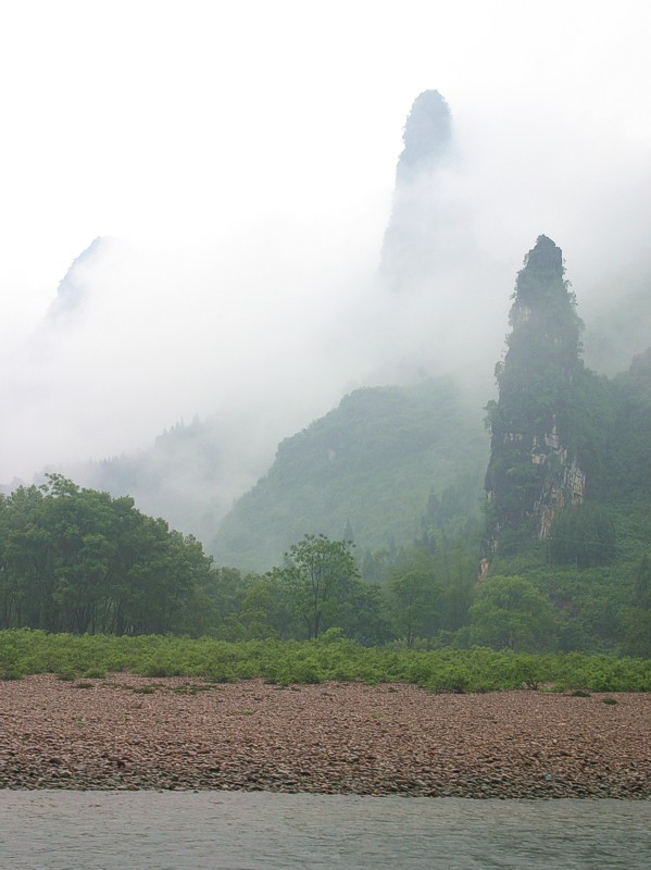 Limestone peaks through early morning fog